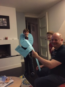 The boys showing Josh the big 40 that we cut out and wrote all the things we love about him.