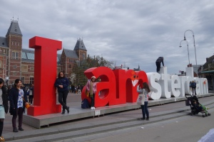 Brenda with one of the I am Amsterdam signs and the Rijksmuseum in the background.