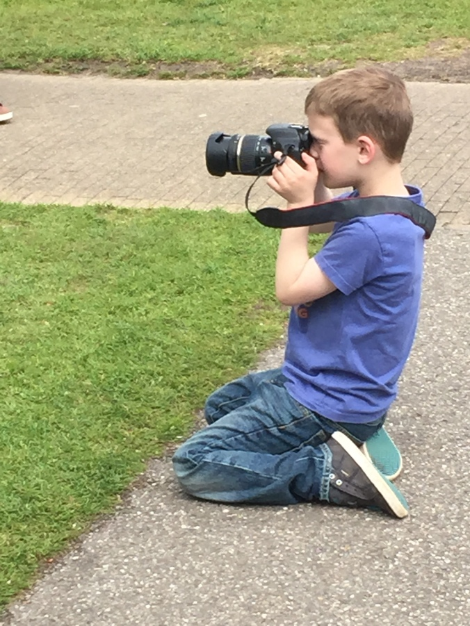 """Liam actually took a number of photos with the """"big"""" camera and loved it.  Perhaps a budding photographer?"""