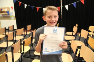 Proud recipient of his Anglia certificate and happy to be moving on to secondary school.