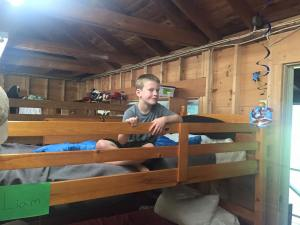 Liam on the top bunk for the 2nd year in a row
