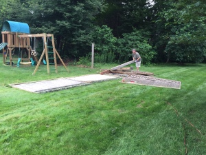 Kyle and my dad helping me to take down my fence (part of our sale agreement).