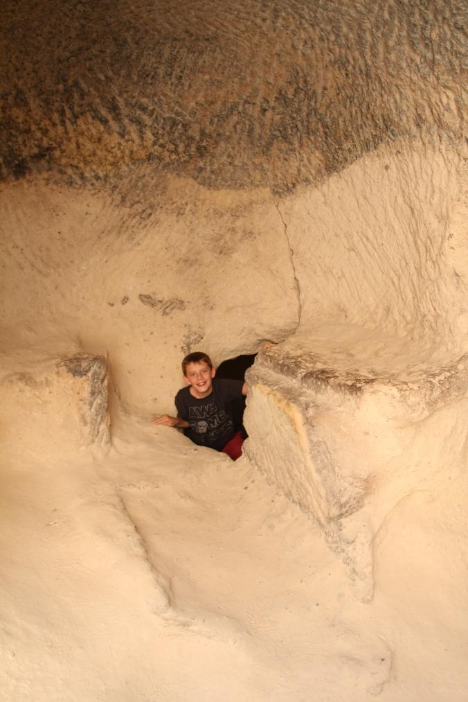 Aidan popping up through a tunnel