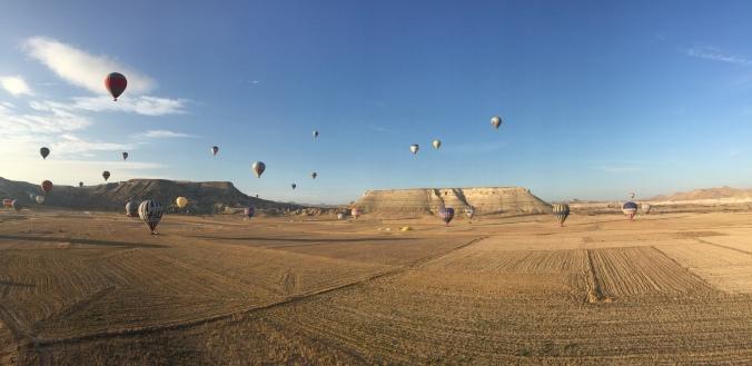 Balloons all starting to land around us