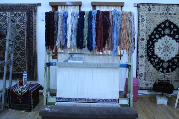 You can see all the various color threads that are being used to make the carpet.
