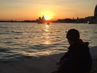 Little kid at sunset