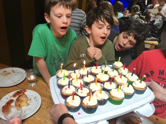 Liam and Orion blow out the candles